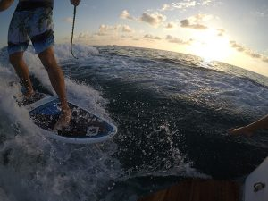Wakesurfing at sunset